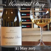An image of a Domaine Divio wine bottle and glass full of wine depicting our Memorial Day event for 2017.