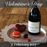 A bottle of Domaine Divio wine and heart-shaped chocolates depicting the Valentine's Day event on February 11, 2017.