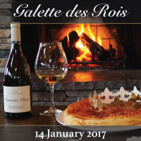 An image of a French galette (cake) and bottle of Domaine Divio wine depicting the Galette des Rois event in January 2017.
